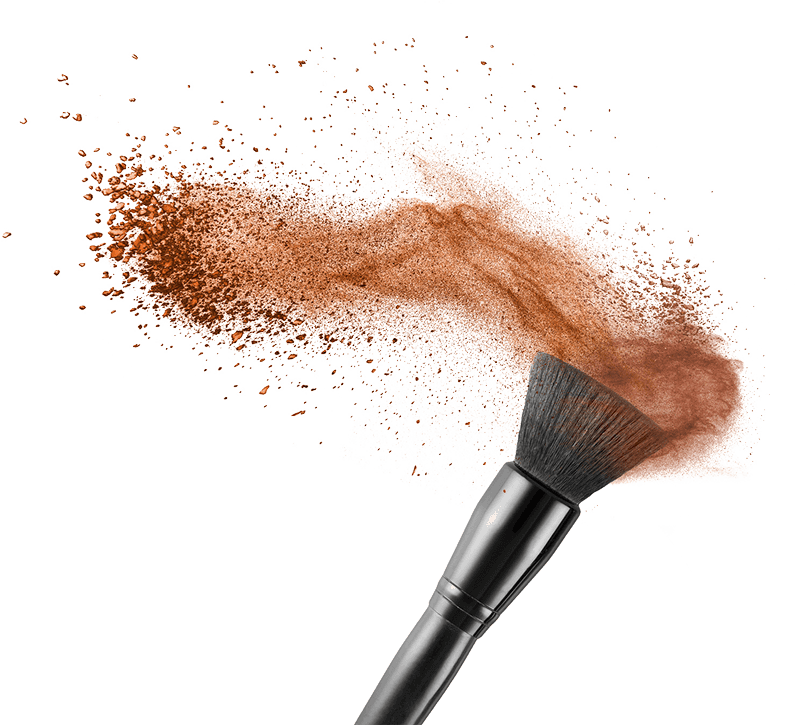 Makeup brush with makeup flying off it
